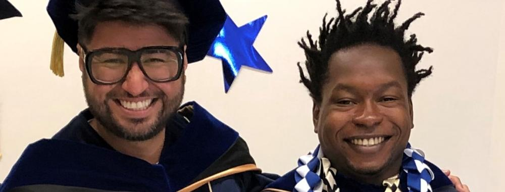 Photograph of two Ph.D. students on graduation day